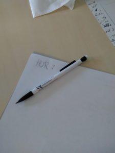 Konferensblock och penna